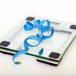 blue-tape-measuring-on-clear-glass-square-weighing-scale-53404-1-1