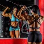 photo-woman-bodybuilder-using-cable-and-pulley-machine-while-1480520