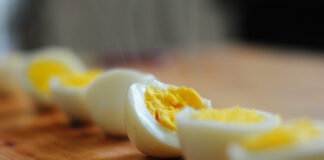 Is it possible to consume a hard-boiled egg that has been left out?